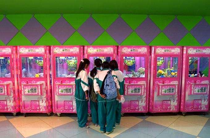 Schoolchildren visit an Arcade inside the South China Mall, the largest shopping mall in China and arguably the largest in the world, located in Dongguan. Designed by architects from the United States and France, the mall, an oasis of entertainment for many citizens and visitors, is still under construction.