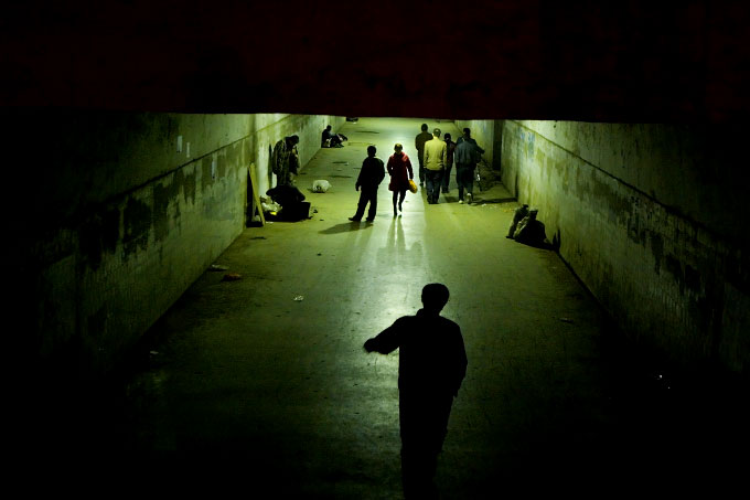 Pedestrians in an underground walkway near the central train station in Zhengzhou, the capital of Henan province.