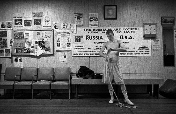 Wrapping up a sparring session at the more than half-century old Sam's Gym in Glouster, Ohio. Daily often looks at the pictures of famous fighters on the wall for inspiration and hope. Boxers at the gym admire Daily's talents, and he receives special treatment from the trainers and coach.