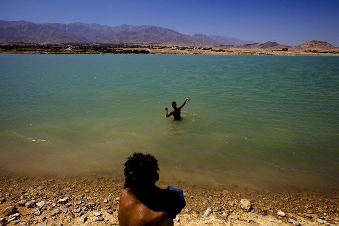 Kids play in Qhargha Lake, located on the outskirts of Kabul city.