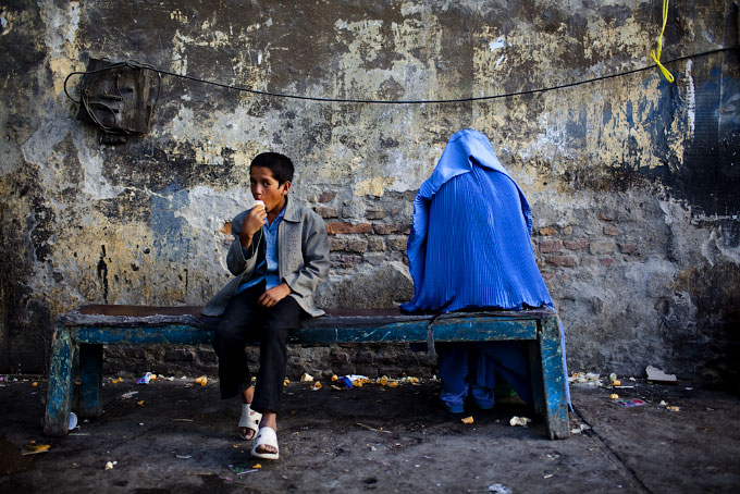 A boy eats an ice cream cone in the Cinema Pamir section of Kabul.