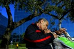 A couple takes a break on a park bench beside Lake Eola.
