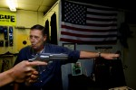 The owner of Reige's Firearms gun shop instructs a student on how to properly shoot a hand gun.