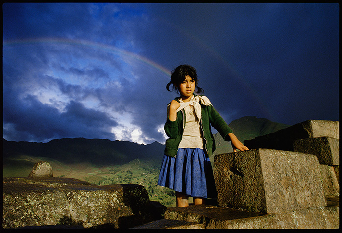 She was walking on the road outside of Cuzco, Peru.And then there was a rainbow.