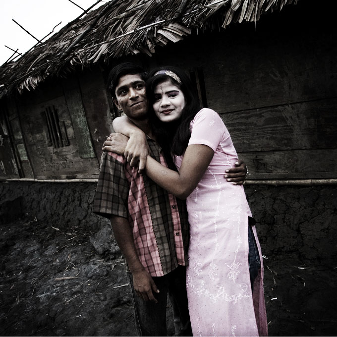 In Baniashanta, a sex-worker is hanging out with a customer. Bani Shanta is a 600 or 700 hundred populated port village in Pashur river and more than half of the residents are sex-workers, making the life of the village dependant on prostitution job. Although in Bangladesh prostitution is practically legal -- anyone can become sex-worker if over 18 --, some of Bani Shanta's workers are children and victims of human trafficking. In addition, many of such sex-workers have children as single mother, and those kids have nearly no future except becoming prostitutes, pimps or drug dealers, since they are likely to grow in the same circumstances without going to school. Bani Shanta, Bangladesh, July 06 2006.