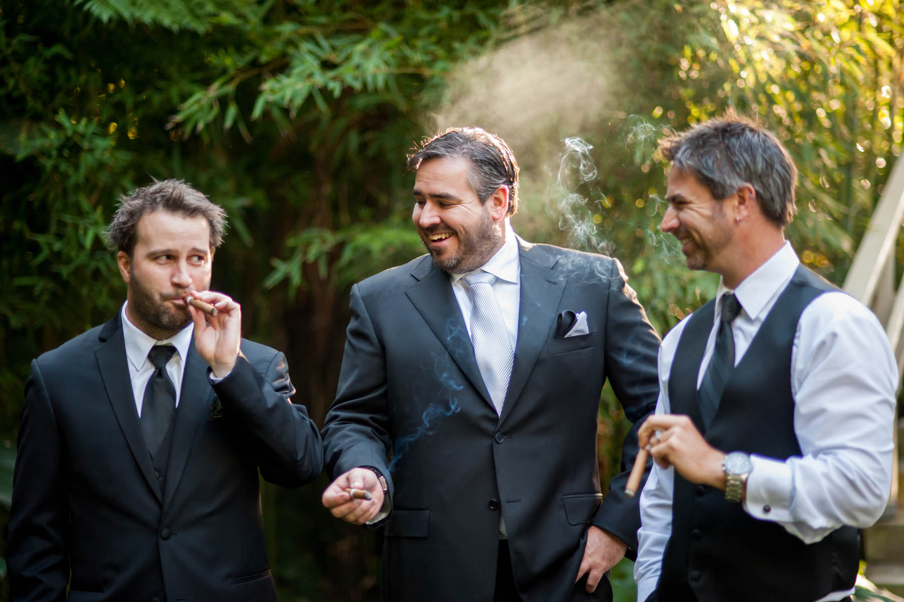 The groom enjoys a cigar with his best mates that have flown in from Austrailia for this wedding at La Venta in Palos Verdes.