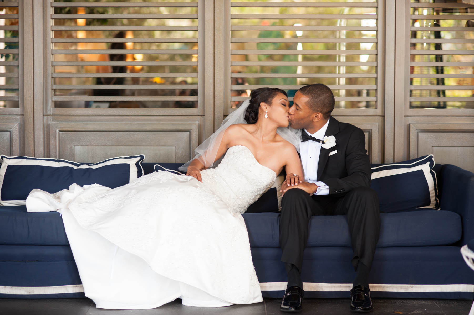 Lovely couple kissing on the nautical blue sofas at Le Meridien Delfina in Santa Monica.