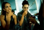 Contestants in the Miss India beauty pageant console themselves by eating the backstage dressing room after being cut from one of the final rounds in the contest at the Bombay Exhibition Grounds in India Saturday, January 27, 2001.  All thirty contestants have spent months virtually starving themselves in preparation for the contest and undergoing rigorous training sessions under the watchful eye of monitors and counselors, and upon their disqualification from hte final contest, many of the girls indulged in chocolates and chips--previously forbidden foods.