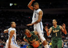 University of South Florida's Augustus Gilchrist ducks under Villanova's Antonio Pena's jump block in first round game of the Big East Tournament at Madison Square Garden by photographer Adena Stevens