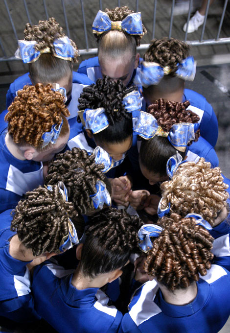 Freehold Giants Midget Small Intermediate cheerleading squad prays in a circle before performing their routine at the Jersey Shore Cheer Competition in Trenton. This is a ritual they do everytime before a compeition. By photographer Adena Stevens