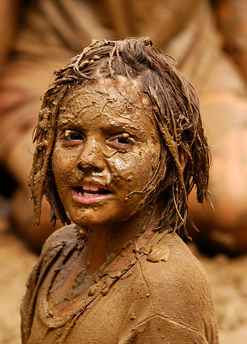 Portrait of Tina Santone covered in mud in South Greensburg, Pennsylvania by photographer Adena Stevens