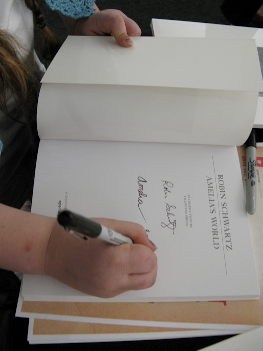 Amelia signing her book