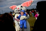 Matthew Crusha, 2, cries while posing with the Easter Bunny for a photograph during part of the annual Imperial Oil and Plumbing Egg Hunt. The hunt was held at South Windsor High School and is conducted by South Windsor Recreation.