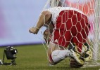 Major League Soccer's New York Red Bulls Tim Ream gets caught in the net after trying to defend on Tottenham Hotspur player Gareth Bale's goal during the second half of their game at Red Bull Arena in Harrison, New Jersey July 22, 2010.
