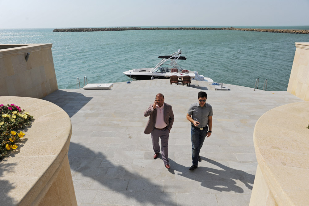 GARADAGH BETWEEN SAHIL AND SANGACHAL, AZERBAIJAN.  (L-r) Ibrahim Ibrahimov, an Azerbaijani oligarch and billionaire, is seen with his assistant and protege, Shahin Talibov, Vice-President of Avesta Concern, at the edge of the Caspian Sea outside one of several of his homes in the Garadagh region just southwest of Baku, Azerbaijan on July 18, 2012.  Ibrahimov is the developer behind the Khazar Islands artificial islands project; in his private life, he enjoys building a home for his family, moving in, and then quickly tires of the property before building a new home on an adjacent lot on his seaside lands.
