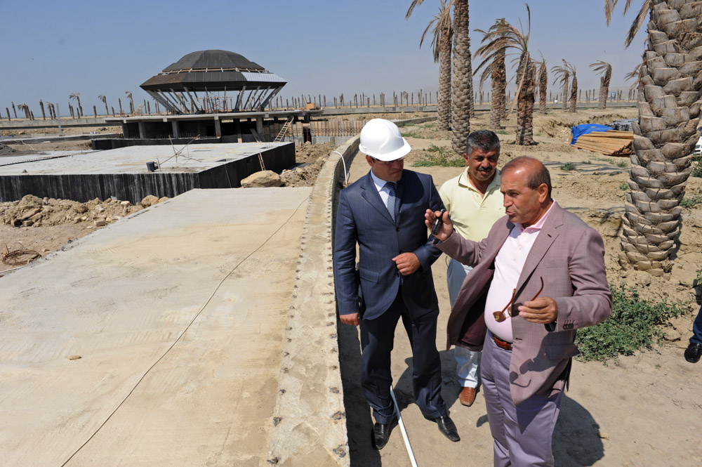 NEAR SAHIL, AZERBAIJAN.  (At right) Ibrahim Ibrahimov, an Azerbaijani oligarch and billionaire, is seen on site of the of the Khazar Islands project on July 18, 2012.  The brainchild of Ibrahimov, the artificial Khazar Islands project just southwest of the Azerbaijani capital Baku is being built at a projected cost of $100 billion with an anticipated 800,000 housing units.