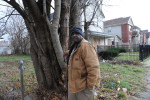 Marvin Reeves stands near the front of the house he bought for his daughter in the Greater Grand Crossing neighborhood in Chicago, Illinois on November 29, 2015.  Reeves purchased and renovated the house with money he received in settlement from the City of Chicago after a codefendant, Ronald Kitchen, and he were both beaten so badly by detectives working under former Chicago Police Commander Jon Burge that their families did not recognize them at arraignment and Kitchen confessed to a crime both were innocent of; Reeves spent 21 years incarcerated from 1988-2009 for a South Side arson that killed two women and three children and had received five consecutive life sentences.
