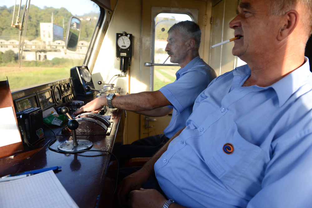 NEAR SARAJEVO, BOSNIA AND HERZEGOVINA.  Train conductors Sakib Buzo, 53, and Izet Golubic, 51, drive the train to Doboj from the train station in Sarajevo, Bosnia and Herzegovina on October 20, 2014.  Buzo and Golubic said they used to drive routes to Belgrade before the war but those were discontinued after the 1992-1995 conflict and routes to cities like Banja Luka inside the Republika Srpska, one of two entities in the present day divided Bosnia and Herzegovina, were discontinued in only the last few years as Serbian nationalism has been on the rise.