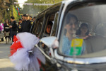 GOYCAY, AZERBAIJAN.  Young women wait in a classic car to greet an official delegation in fine dresses during the Pomegranate Festival on November 4, 2011.