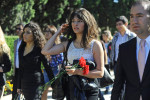 BAKU, AZERBAIJAN.  Young women of the pro-government youth organization Ireli, translation {quote}Forward,{quote} carry red carnations to the tomb of Heydar Aliyev, the father of the current president of Azerbaijan, Ilham Aliyev, and the second president since the country's independence from the Soviet Union in 1991, on October 14, 2011.  A visit to the tomb of Heydar Aliyev is part of the World Youth Festival which brought young people from around the world to Azerbaijan as part of a week-long tour to showcase Azerbaijan and extol the virtues of the country and the culture to foreigners.