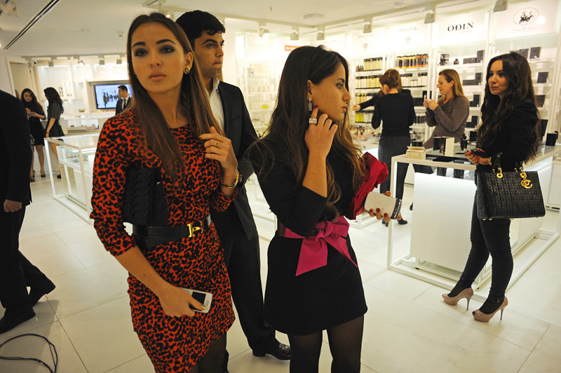 BAKU, AZERBAIJAN.  Young female customers arrive at the grand opening celebration of Emporium's second store at the Port Baku luxury residences on October 28, 2011.  Emporium's second store in Baku was designed by Japanese architect Yukio Ishiyama of the Milanese design firm Garde and features over 150 luxury ready-to-wear brands such as Azzedine Alaïa, Marc Jacobs and Stella McCartney; Emporium is widely considered to offer the greatest variety of high-end designer shopping in Baku under one roof.