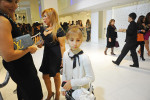BAKU, AZERBAIJAN.  A young girl stands beside her mother and a friend at the grand opening celebration of Emporium's second store at the Port Baku luxury residences on October 28, 2011.  Emporium's second store in Baku was designed by Japanese architect Yukio Ishiyama of the Milanese design firm Garde and features over 150 luxury ready-to-wear brands such as Azzedine Alaïa, Marc Jacobs and Stella McCartney; Emporium is widely considered to offer the greatest variety of high-end designer shopping in Baku under one roof.