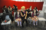 BAKU, AZERBAIJAN.  Husniye Maharramova, a presenter on Ictimai TV interview three small children, including two young twin girls, during an open casting call for a Eurovision promotional video at the Baku Business Center on the Bulvar in downtown Baku, Azerbaijan on January 6, 2012.  The open casting call for the promotional video was one effort to involve Azerbaijanis in the Eurovision Song Contest; 387 people responded to the open call.