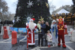 BAKU, AZERBAIJAN.  An Azerbaijani family poses in front of a New Year's tree with figures of Azeri New Year's, Grandfather Frost, who bears a striking resemblance to Santa Clause, and Snow Girl as well as a dragon at the start of the New Year's holiday on December 30, 2011.  A majority Muslim country where 99 percent of the population is Shi'a, traditions with a Christian origin associated with the Christmas holidays were adopted to meet local religion and took on a New Year's character during 71 years of Soviet domination from 1920-1991.