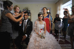 GIVRAKH, NAKHCHIVAN AUTONOMOUS REGION, AZERBAIJAN.  Farid Aliyev, 23, and Khanim Veliyeva, 20, pose for pictures in his home on the third day of a traditional three day wedding on July 15, 2012.   Once the bride is delivered to the groom's family's house, she will stay with the family and live the rest of her life in her new home.