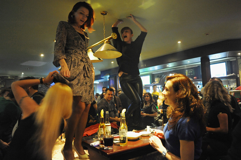 BAKU, AZERBAIJAN.  Women dance on the tables at Shakespeare bar on March 18, 2012.