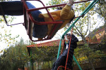 NEAR GOYGOL, AZERBAIJAN.  Volunteers Sevinc Sultanova, 25, with the pro-government youth organization Ireli (translation, {quote}Forward{quote}), and Gulnaz Mahmudova, 23, of the European Students Forum, play on swings during the World Youth Festival on October 17, 2011. The World Youth Festival brought young people from around the world to Azerbaijan as part of a week-long tour co-sponsored by Ireli to showcase Azerbaijan and extol the virtues of the country and the culture to foreigners.