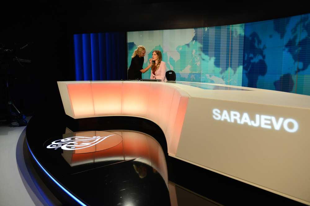 SARAJEVO, BOSNIA AND HERZEGOVINA.  (L-r) Makeup artists Esefa Zornic, 30, touches up news anchor Marina Ridjic, 28, just before going on air on Al Jazeera Balkans in the BBI Center, which was designed by architect Sead Golos, on October 10, 2014.  Qatari-financed Al Jazeera Balkans launched in November 2011 and is an anchor tenant of the BBI Center.