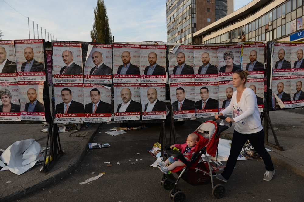 SARAJEVO, BOSNIA AND HERZEGOVINA.  A woman pushes a stroller passed election posters for the Union of Social Democrats ahead of October 12 national elections on October 8, 2014.