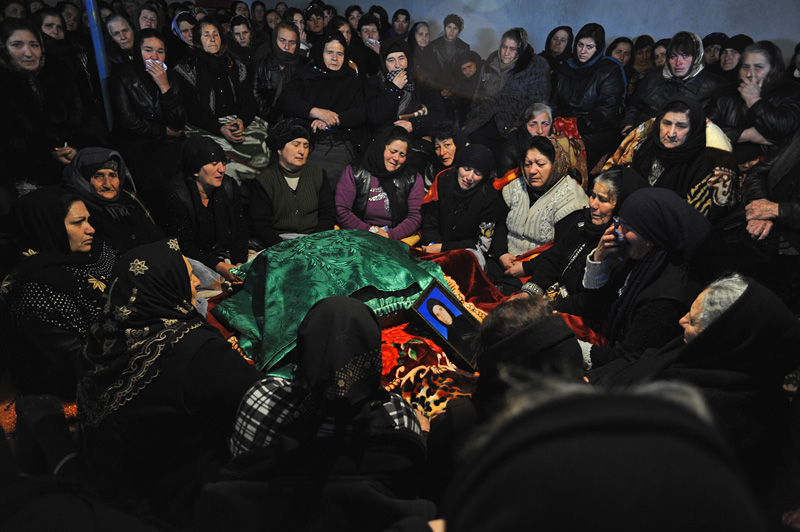 ZAYAM, AZERBAIJAN.  Women during the crying ceremony during the seven day ceremony, part of Azerbaijan's elaborate funeral rituals that include gender segregated commemorations of the deceased three days, seven days and 40 days after their death in Zayam, Shamkir Region, Azerbaijan, approximately four kilometers from the Baku-Tbilisi-Ceyhan (BTC) oil pipeline, on January 3, 2012.  Compensation funds for land traversed by the BTC pipeline paid to the family of the deceased as a result of disruption stemming from the period of the pipeline's construction totaled under $1,000 and went to keeping the deceased healthy and caring for her daughter who suffers from tuberculosis.
