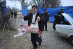 ZAYAM, AZERBAIJAN.  A man takes a lamb carcass from the trunk of a car for butchering before cooking for women mourners during the seven day ceremony, part of Azerbaijan's elaborate funeral rituals that include gender segregated commemorations of the deceased three days, seven days and 40 days after their death in Zayam, Shamkir Region, Azerbaijan, approximately four kilometers from the BTC pipeline, on January 3, 2012.  Compensation funds for land traversed by the BTC pipeline paid to the family of the deceased as a result of disruption stemming from the period of the pipeline's construction totaled under $1,000 and went to keeping the deceased healthy and caring for her daughter who suffers from tuberculosis.