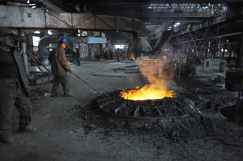 RUSTAVI, GEORGIA.  Workers smelting scrap metal before it is converted to steel at the Rustavi Steel plant in Rustavi, Kvemo Kartli region, Georgia on January 20, 2012.  Built in 1946 at the height of Stalinist power in the Soviet Union and upgraded in recent years, Rustavi Steel employs 1,750 in what was once the greatest industrial center of Soviet Georgia; today several heavy industry factories remain in the city which is traversed by the Baku-Tbilisi-Ceyhan oil pipeline.