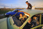 REYHANLI, TURKEY.  Syrian children play in a junkyard of old, abandoned and destroyed vehicles at the entrance to the Reyhanli tent city in Reyhanli, Turkey on February 26, 2012.  As the year old rebellion against the rule of Bashar Al-Assad continues just across the border in Syria, Turkey has seen a continued influx of refugees from the Syrian conflict but has not granted them refugee status and instead considers them to be {quote}guests{quote} of Turkey; Turkey's border with Syria is just one hour from the Ceyhan Marine Terminal where the Baku-Tbilisi-Ceyhan oil pipeline ends its 1,100 mile journey at the Mediterranean port.