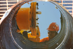CEYHAN MARINE TERMINAL, TURKEY.  A Philipino worker seen through a bucket to catch leaking crude oil secures a valve after loading Azeri crude oil from the Baku-Tbilisi-Ceyhan oil pipeline onto a Greek oil tanker, The Aegean Myth, on August 16, 2010 before setting sail for Rotterdam, The Netherlands.
