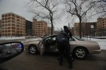 CHICAGO, ILLINOIS.  A young black male is stopped by a Chicago police officer and frisked in the middle of the Cabrini Green housing project on Chicago's Near North Side on February 8, 2008.