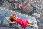Jori Boyer, 4, of La Crescent, Minnesota lays down on the newly opened glass balconies {quote}The Ledge{quote} at the Skydeck at the Sears Tower in Chicago, Illinois on July 6, 2009.