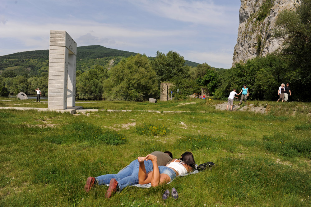 DEVIN, SLOVAKIA.  Visitors are seen near the recently constructed monument to those who died trying to escape the communist regime by crossing into Austria by swimming a mere 40 meters across the Danube on June 26, 2010.  Located beside the Devin castle, the once heavily fortified crossing point, among the most narrow in the former eastern bloc, was and remains a popular spot for local tourists and day trippers as the oldest castle ruins in Slovakia are perched on the adjacent hillside.