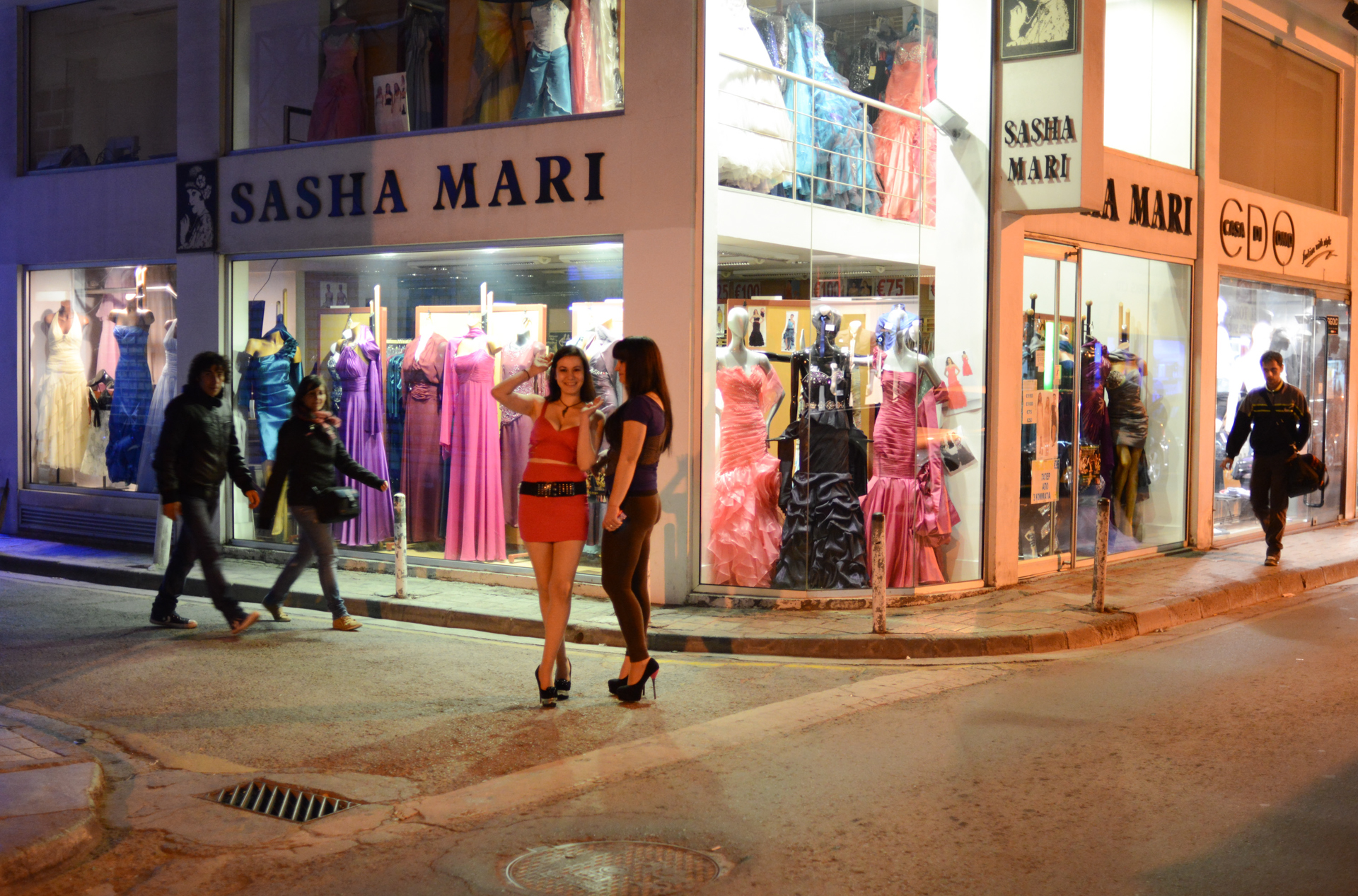 NICOSIA, CYPRUS.  Girls are seen walking the streets outside a cabaret on March 26, 2013. As the Cypriot banking sector collapses, the country's economy has been labeled a {quote}casino economy{quote} by unsympathetic officials in Brussels and Berlin; Nicosia's downtown has a seedy side of after-hours prostitution and cabaret.