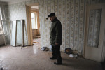 BAKU, AZERBAIJAN.  Khaliq Bagirov, 72, stands in the shell of his former living room in his partially demolished apartment at 5 Agil Guliyev Street, a building which was occupied by military families and stood beside the newly built Crystal Hall, the planned site for the Eurovision Song Contest, on February 18, 2012.  Bagirov lived in the apartment with his son, his wife and their two grandchildren until the government forced their eviction to clear the area surrounding Crystal Hall.