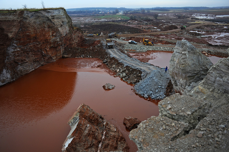 <b>AJKA, HUNGARY.</b>  The rupture in the toxic red alumina sludge reservoir as seen from the top of a remaining piece of the reservoir's wall at the MAL plant on November 22, 2010, that sent a torrent of toxic red alumina sludge pouring into the surrounding countryside, several villages including Kolontar and Devecser and resulted in the death of ten individuals, including a 14 months old baby, injured hundreds and left several families homeless.