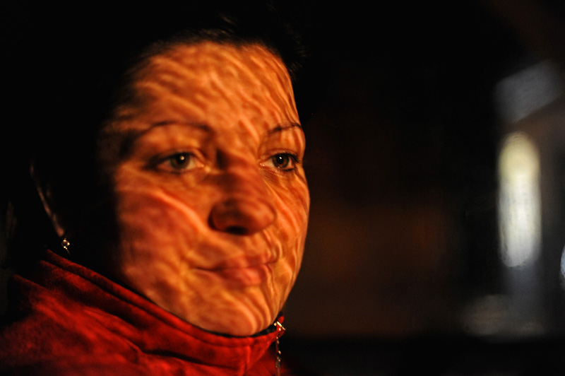 KOLONTAR, HUNGARY.  Melinda Lehmann, 28, sits in her car outside her family's bar on November 22, 2010.  An industrial accident in nearby Ajka, Hungary destroyed her family's home on October 4, 2010 when a flood of toxic red alumina sludge came gushing through her village, the closest to a collapsed reservoir wall that caused the accident, Hungary's worst ecological disaster.