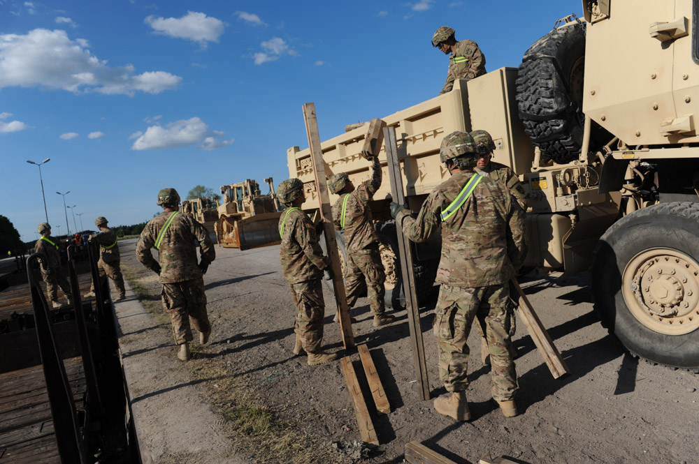 DRAWSKO POMORSKIE TRAINING AREA, POLAND.  American soldiers with the 15th Engineer Battalion help unload $28.5 million of equipment for a two week-long NATO exercise on June 10, 2015.  NATO is engaged in a multilateral training exercise {quote}Saber Strike,{quote} the first time Poland has hosted such war games, involving the militaries of Canada, Denmark, Germany, Poland, and the United States.