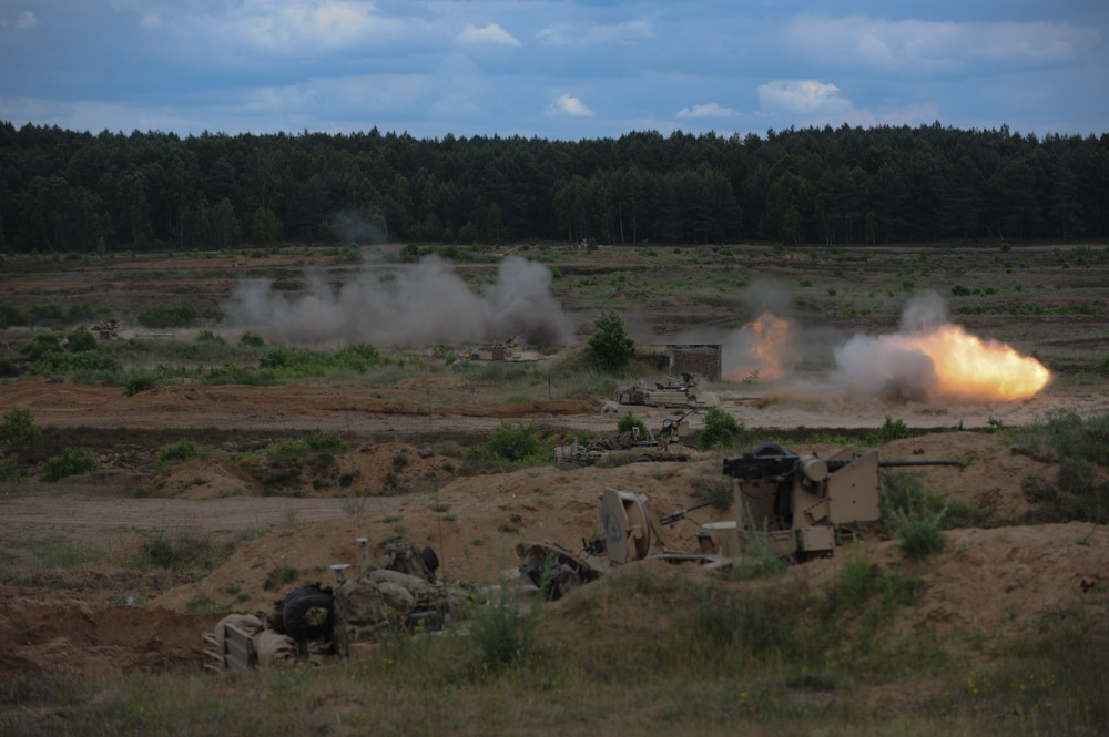 DRAWSKO POMORSKIE TRAINING AREA, POLAND.  The 2nd Battalion, 7th Infantry Regiment, 1st Armored Brigade Combat Team, 3rd Infantry Division based out of Fort Stewart, Georgia with American Abrams M1A2 tanks during a live fire exercise on June 16, 2015.  NATO is engaged in a multilateral training exercise {quote}Saber Strike,{quote} the first time Poland has hosted such war games, involving the militaries of Canada, Denmark, Germany, Poland, and the United States.