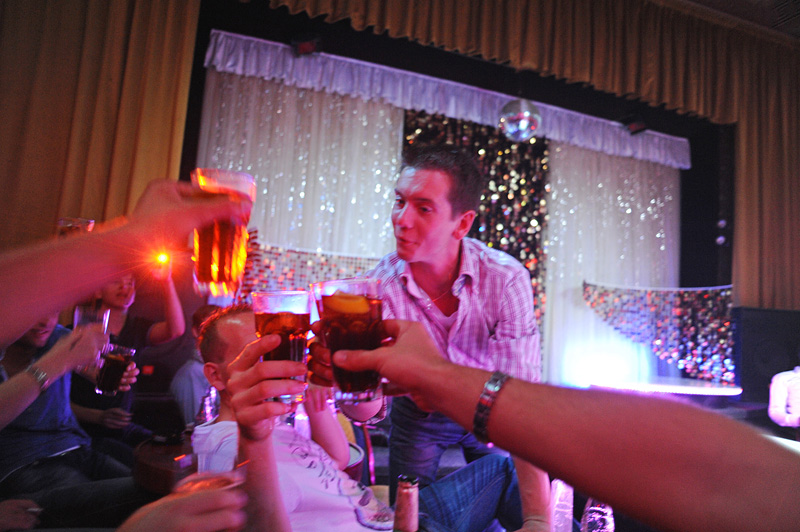 PRAGUE, CZECH REPUBLIC.  Stag night tourist and soon to be married Michael Klos, 23, of Rotterdam, the Netherlands toasts with his friends at the Goldfinger strip club on Weneslaus Square in Prague, Czech Republic on August 12, 2011.