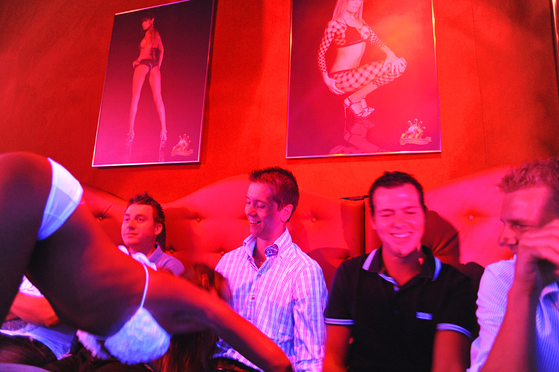 PRAGUE, CZECH REPUBLIC.  Stag and soon to be married (second from left) Michael Klos, 23, receives a table top lap dance as friends (l-r) Roald de Jongh, 24, Ronald Stelt, 23 and Herman Bruinslol, 23, of Rotterdam, the Netherlands look on at Hot Peppers in Prague, Czech Republic on August 12, 2011.