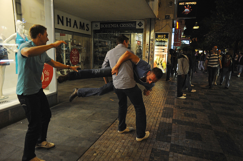 PRAGUE, CZECH REPUBLIC.  Stag tourists Angelo Eleveld, 22, picks up and spins his friend Sietse Dehaam, 23, as Roald de Jongh, 24, of Rotterdam, the Netherlands tries to spank him as he turns mid-way through the night on Weneslaus Square in Prague, Czech Republic on August 12, 2011.